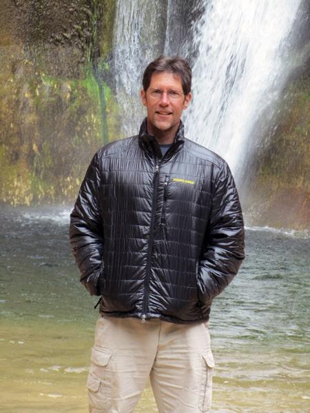 Me wearing the Brooks-Range Cirro Jacket at Lower Calf Creek Falls.