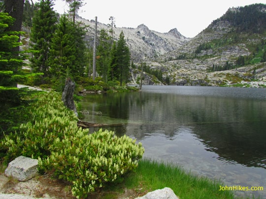 Lower Canyon Creek Lake in the Trinity Alps. Wedding Cake and Thompson Peak cap the far skyline.