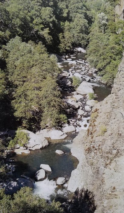 Black Rock looms over Mill Creek near Ishi Wilderness in Lassen National Forest. It's just upstream of the Black Rock Campground on Ponderosa Way. Good swimming and good fishing in Mill Creek!