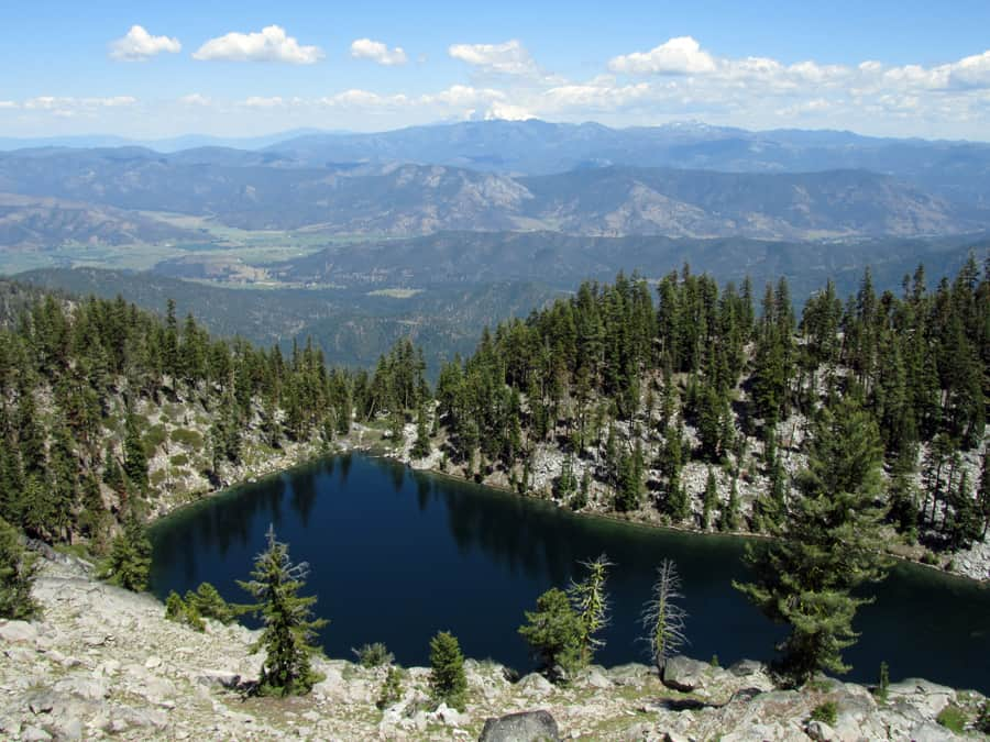 View of Smith Lake, Scott Valley, and Mount Shasta from the Pacific Crest Trail near Russian Wilderness in the Klamath National Forest.