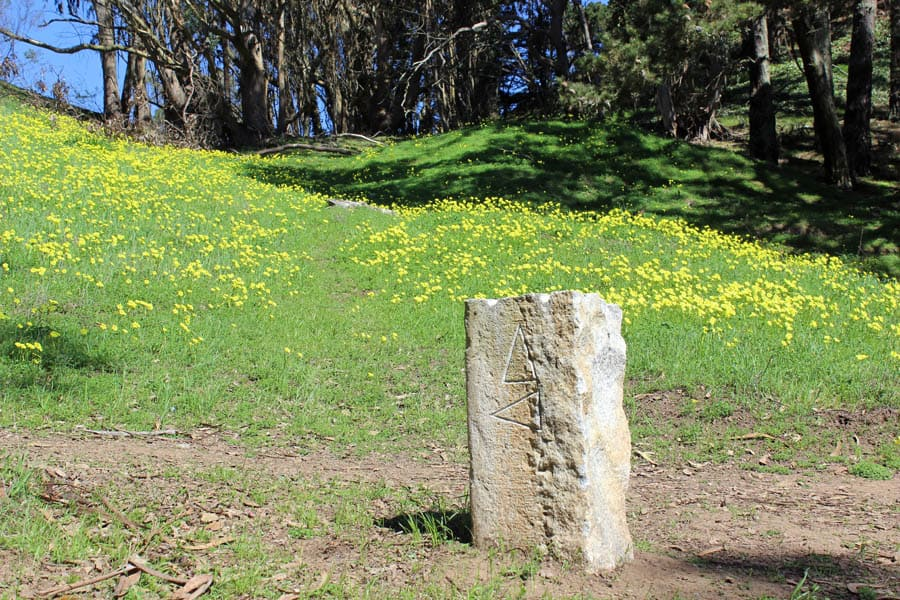 Stone pillars with arrows guide hikers on McLaren Park's 2.7-mile Philosopher's Way hike.