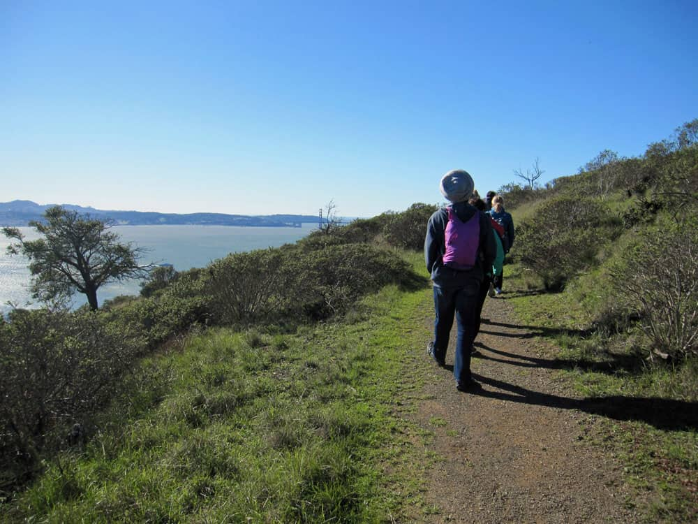 Taking in the beauty on a flat portion of an Angel Island Trail.