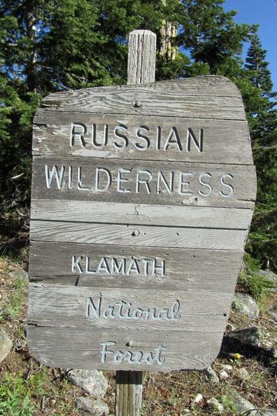 Wooden sign: Russian Wilderness, Klamath National Forest.
