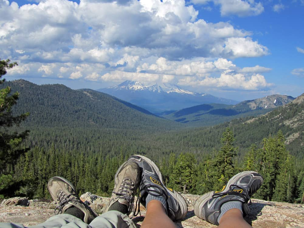 Resting and taking in the view of Mount Shasta. Near the PCT on the Seven Lakes Basin hike.