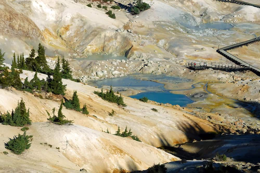 The Bumpass Hell Trail leads to Bumpass Hell, a hydrothermal area that demonstrates the volcanic geology of Lassen Volcanic National Park.