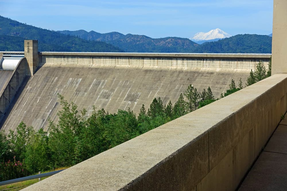 Close-up view of Shasta Dam from beside the Visitor Center, with snowy Mount Shasta in the distance.