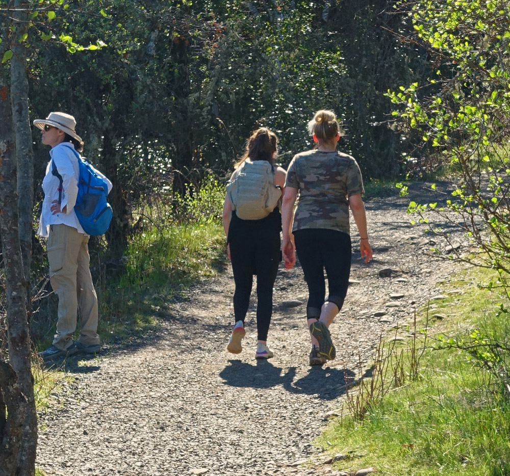 Bad social distancing during the coronavirus pandemic: two hikers walk too close to another hiker on the Lower Table Rock Trail in Southern Oregon.
