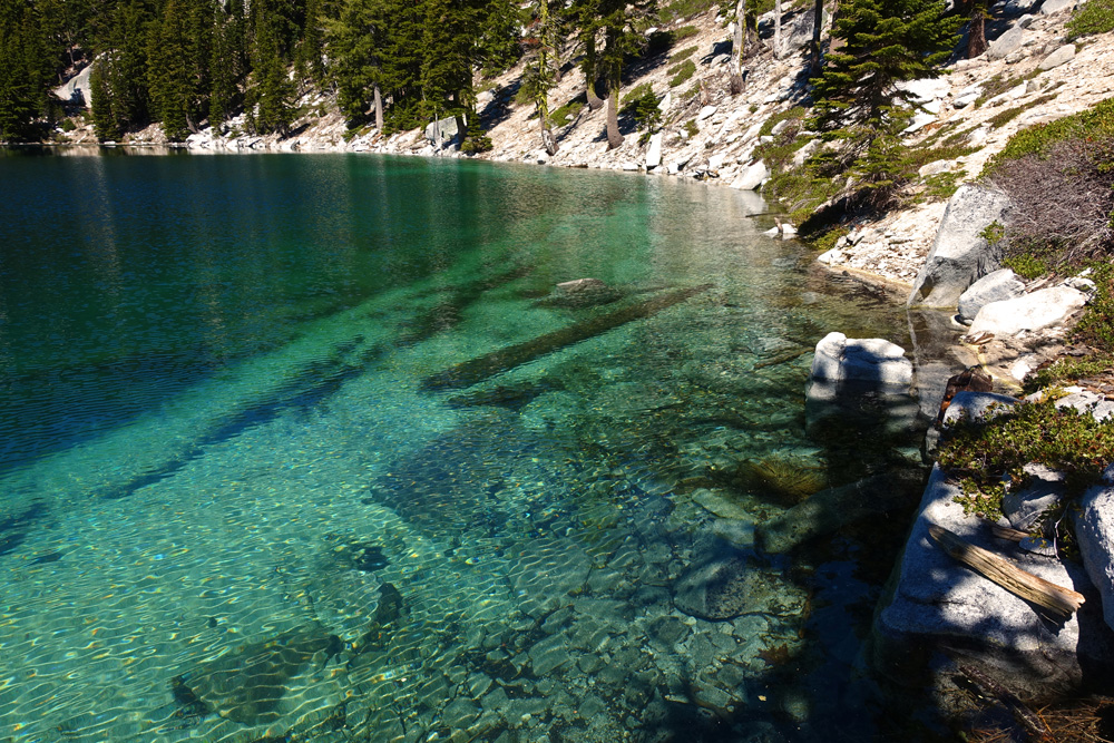 You can find solitude while day hiking or backpacking in the California mountains. You must hike cross-country far from trails to find this secluded lake.