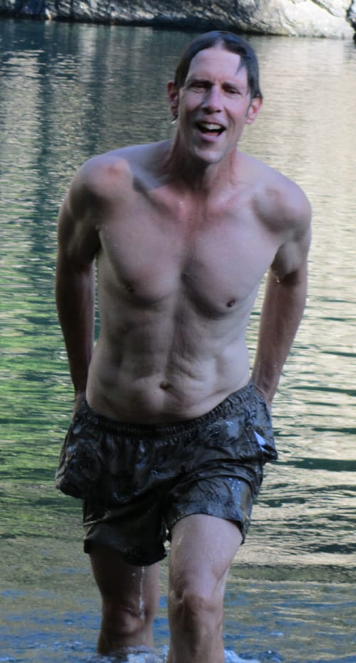 Author John Soares swimming at Myrtle Beach, Middle Fork Smith River: coming out of the cold water.