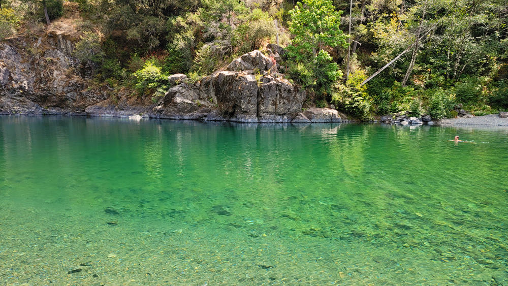 Myrtle Beach Swimming Hole on the Smith River: a swimmer enjoys the cold, clear water